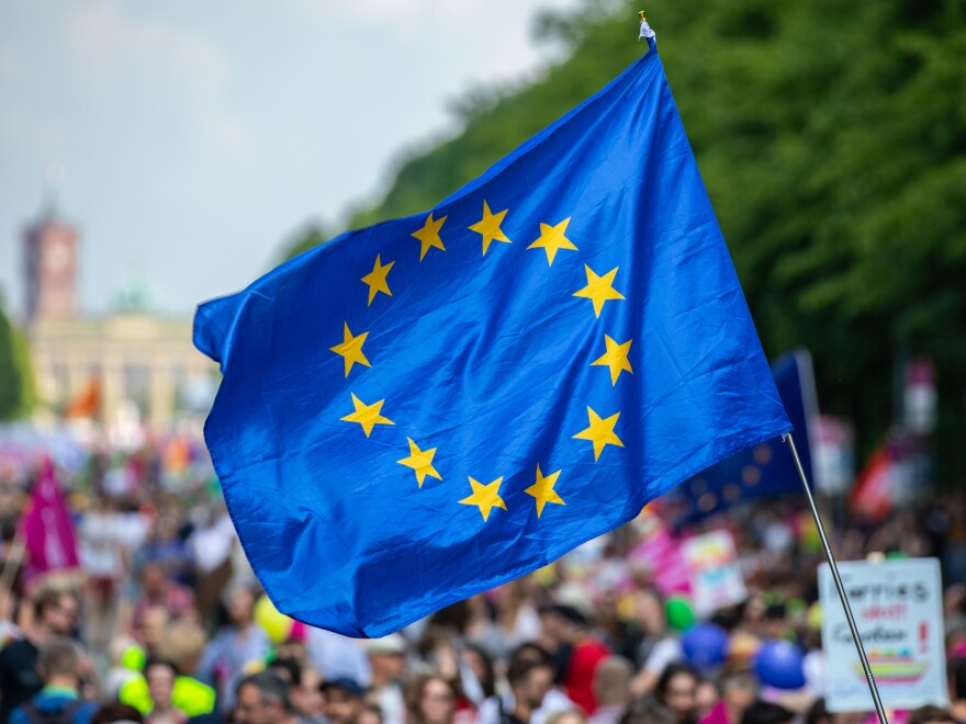 """A protester waves the European Union flag during the pro-Europe demonstration """"One Europe for All: Your voice against nationalism,"""" a week before Sunday's European elections in Berlin, on May 19."""