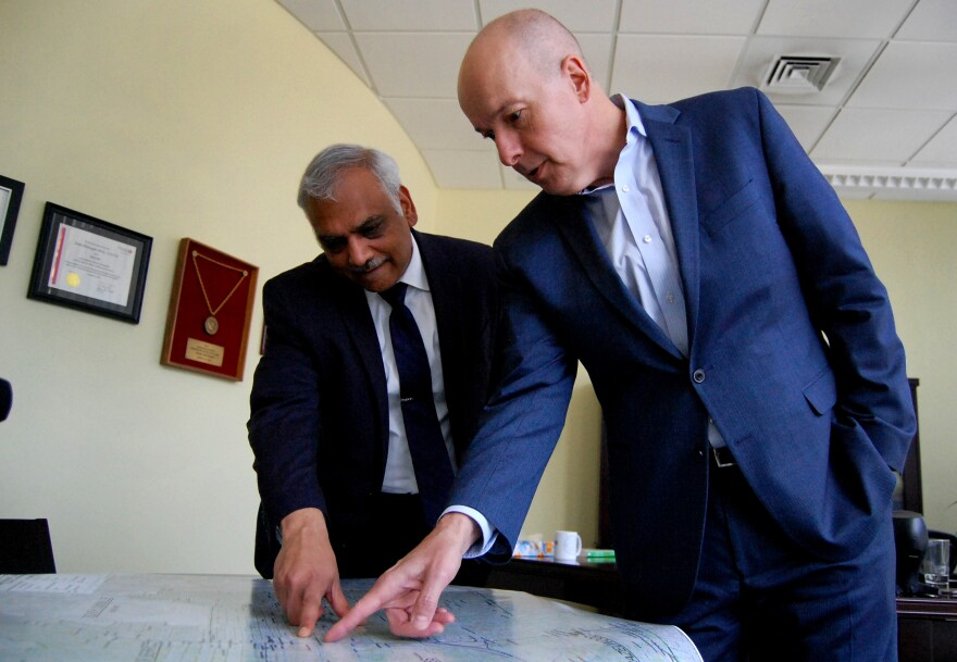 Aruni Bhatnagar (from left) and Ted Smith, researchers at the University of Louisville's Christina Lee Brown Envirome Institute, point to the areas in the city where their team is planting trees.