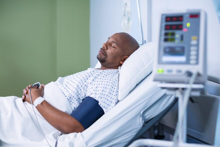 sleeping_patient_in_hospital_bed.jpeg
