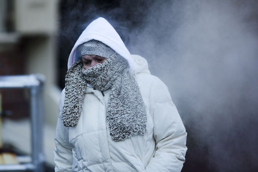 A commuter walks along Market Street in freezing temperatures on Tuesday in Philadelphia.