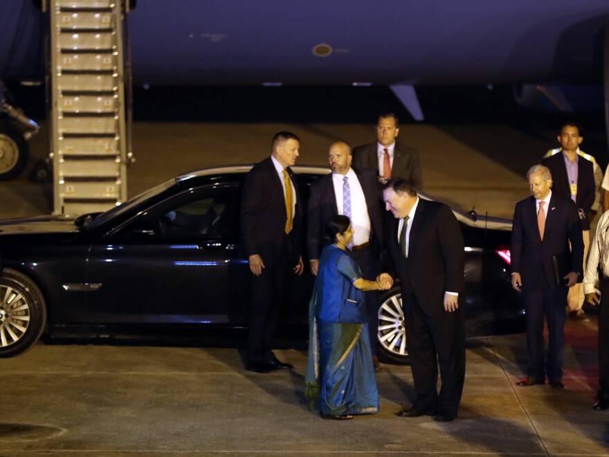 Secretary of State Mike Pompeo is greeted by Indian External Affairs Minister Sushma Swaraj on his arrival at the airport in New Delhi on Wednesday.