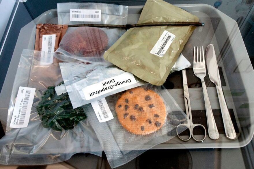 Vacuum-sealed space food — including a beef steak, spinach, a cookie, and an orange grapefruit drink — was on display inside the NASA lunar habitat, designed by Lockheed Martin, during the 35th Space Symposium in Colorado Springs, Colo., in April.