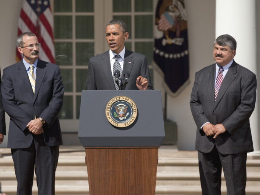 President Obama speaks in the Rose Garden on Wednesday, flanked by U.S. Chamber of Commerce Chief Operating Officer David Chavern (left) and AFL-CIO President Richard Trumka. The business community and unions have pulled Obama in opposite directions over the last couple years.