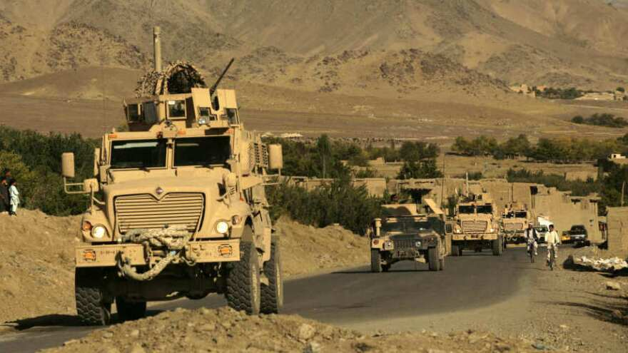 U.S. Army mine-resistant armored vehicles (MRAPs) and Afghan National Army vehicles pass through a village during a joint patrol in the Jalrez Valley in Afghanistan's Wardak province. On Monday, factory workers who produce MRAPs in York, Pa., rallied to protect the Pentagon budget against the automatic budget cuts that will take effect in 2013.