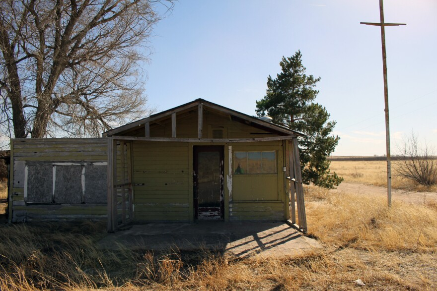 An abandoned gas station is one of the last few remaining buildings at Dearfield.