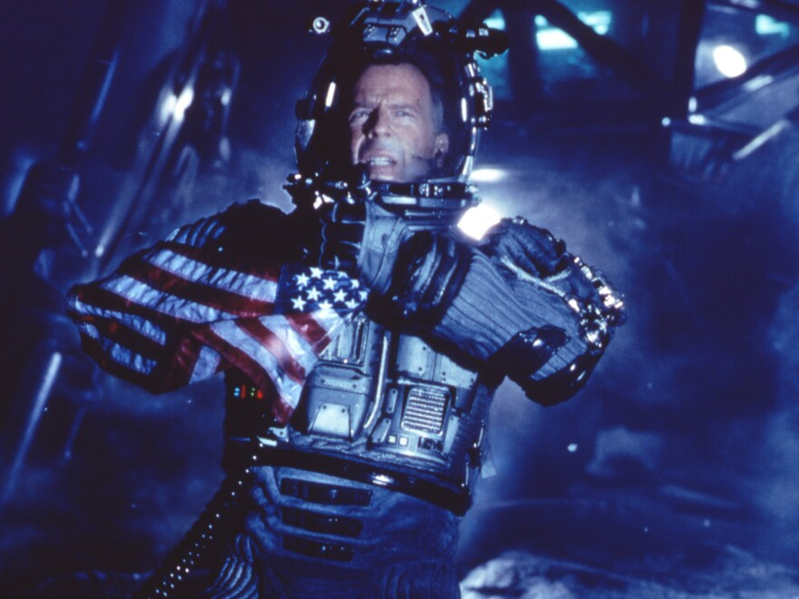 Actor Bruce Willis appears on the surface of an asteroid in a scene from the movie <em>Armageddon</em>.