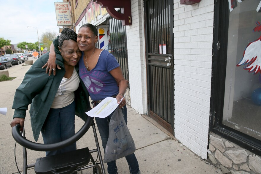 "Sarah White (right) hugs ""Mother"" Martha Freeman, known as the change-maker or a violence-interrupter, in the Garden Homes Park neighborhood of Milwaukee, Wis."