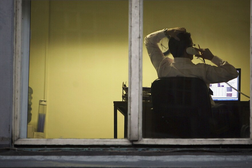 A city office employee works into the night as darkness closes in on October 10, 2005 in Glasgow, Scotland. (Christopher Furlong/Getty Images)