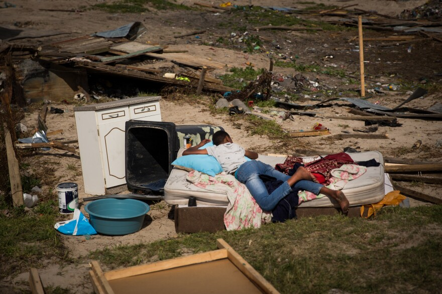 Possessions were strewn in the dirt after a settlement near Covid was dismantled by the authorities. In many cases, settlement residents will rebuild within days of such a local government action.