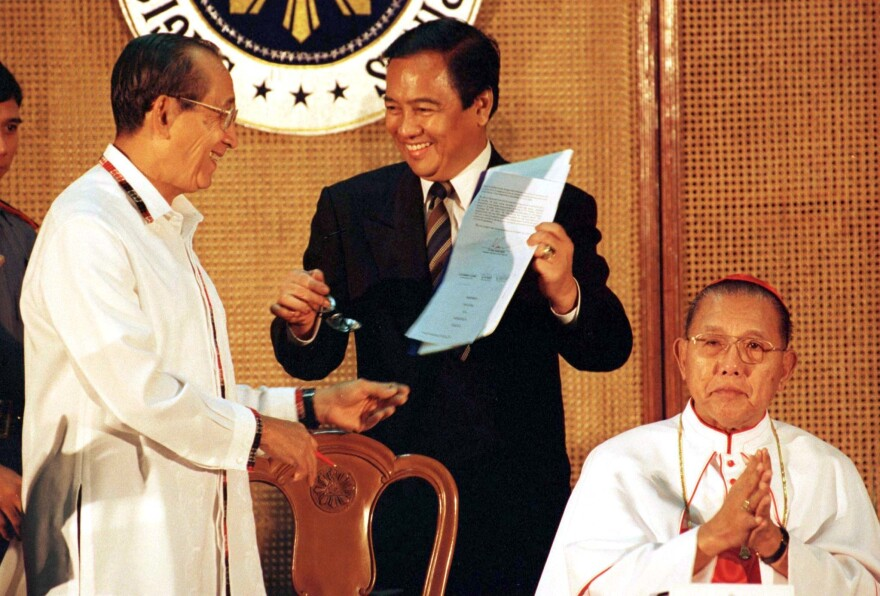 Senator Heherson Alvarez (center) with Philippine President Fidel Ramos (left) in 1997.