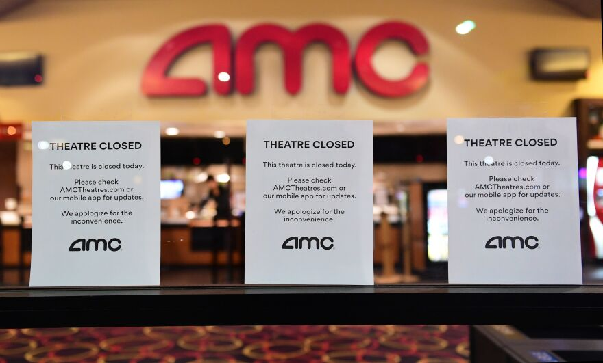 None of the three major national theater chains — AMC Theatres, Regal Cinemas and Cinemark — have plans to reopen before June. Above, signs are posted in front of the AMC in Montebello, Calif., on March 17, 2020.