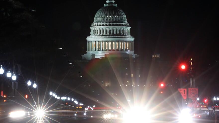 Traffic streaks past the U.S. Capitol last month in Washington, D.C.