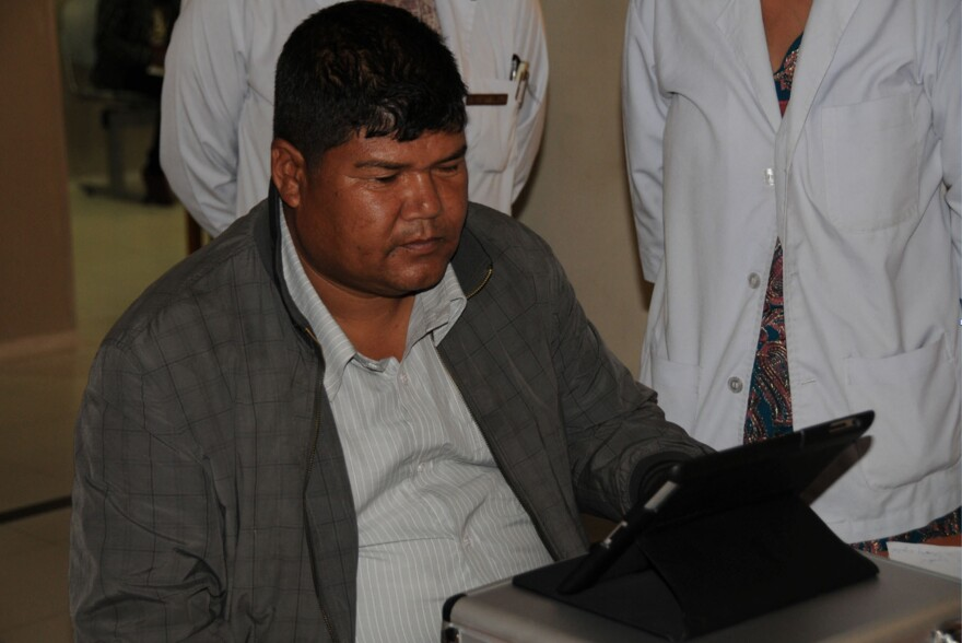 Visual field testing usually requires an expensive machine. This man in Nepal helped test an iPad app.