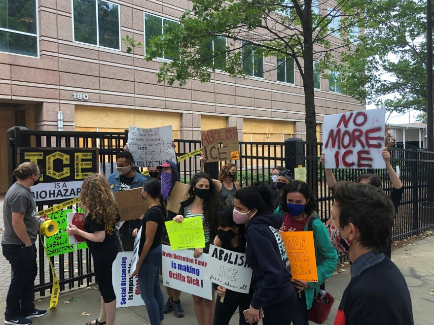 Protesters at a news conference outside ICE's Atlanta field office in September after the release of a whistleblower report about conditions at Irwin County Detention Center in Ocilla, Ga.