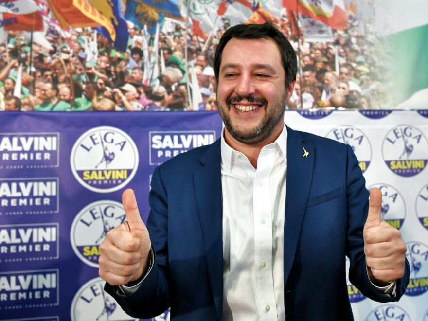 """Italian far-right League party leader Matteo Salvini gives the thumbs-up in Milan on Monday. Salvini said his right-wing coalition had the """"right and the duty"""" to form a government after taking 37 percent of the vote in the weekend election."""