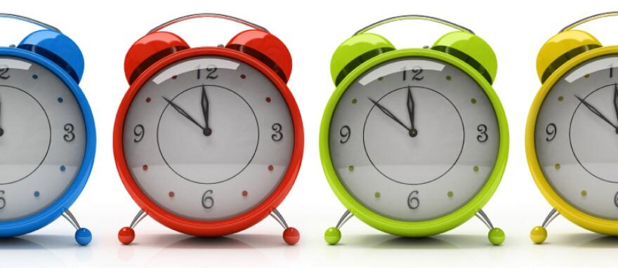 Alarm clocks about to strike 12.