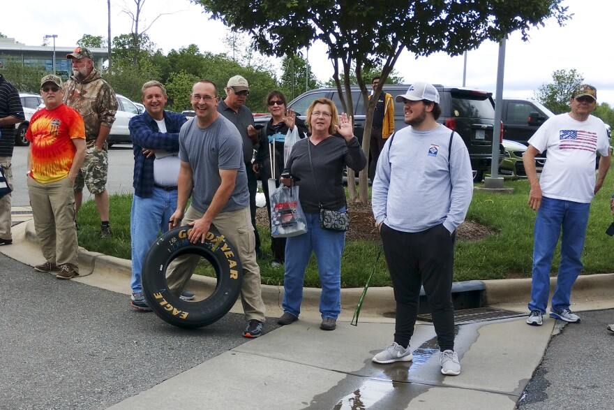 Dale Earnhardt fans gathered outside Hendrick Motorsports in Concord on Tuesday as Earnhardt talked about his retirement inside. That's Travis Parsons of Des Moines with a tire he got at the team shop.