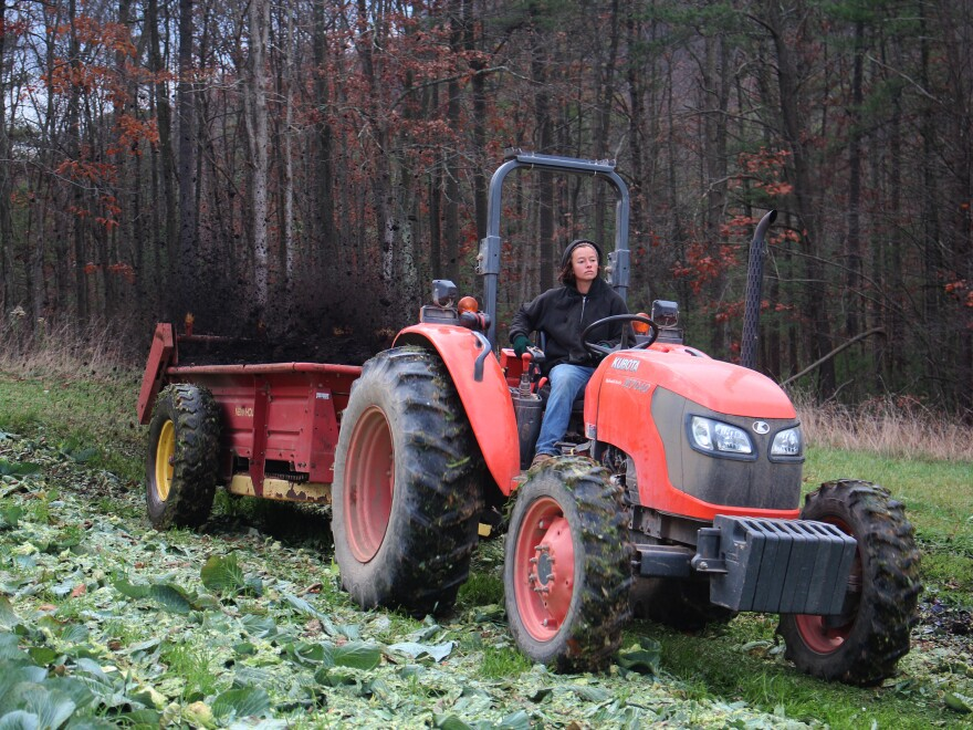 Pearl Wetherall, field manager at New Morning Farm, spreads manure.