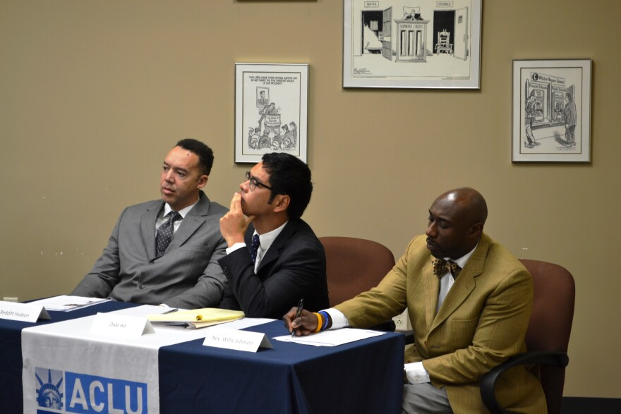 Ferguson-Florissant parent Redditt Hudson (left), attorney Dale Ho, and past school candidate Willis Johnson at a news conference announcing a lawsuit against the Ferguson-Florissant schools on December 18.