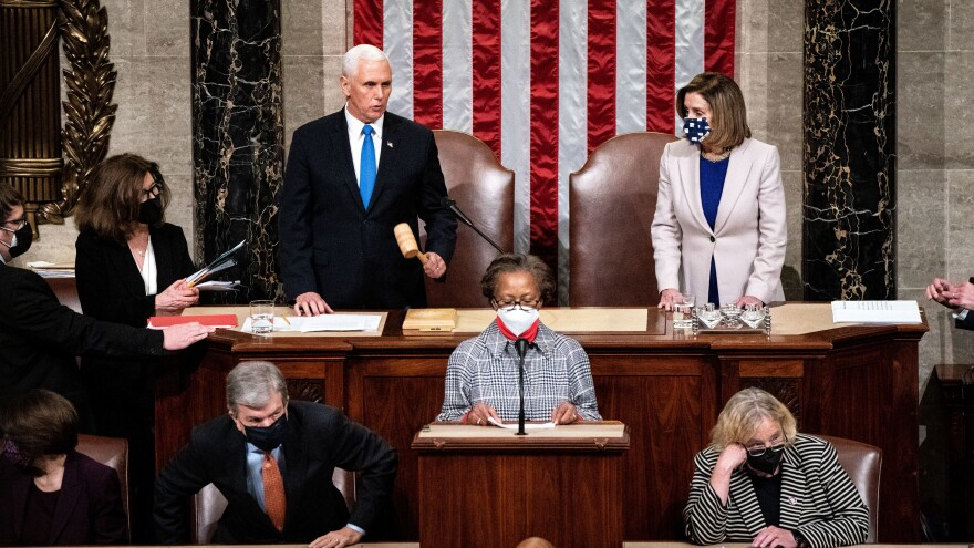 Vice President Mike Pence and House Speaker Nancy Pelosi, D-Calif., preside over a joint session of Congress to ratify President-elect Joe Biden's 306-232 Electoral College win over President Donald Trump, hours after a pro-Trump mob broke into the U.S. Capitol and disrupted proceedings.