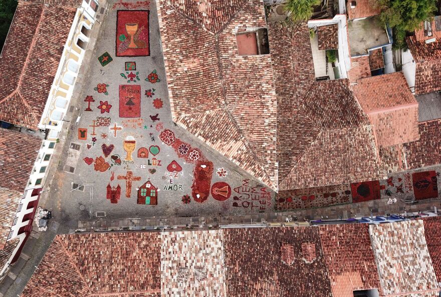 An aerial picture shows sawdust rugs decorating a street in the Brazilian historic city of Ouro Preto, in the state of Minas Gerais, before an Easter procession representing the resurrection of Christ. The streets are decorated by locals and tourists who use about 60 tons of colored sawdust.