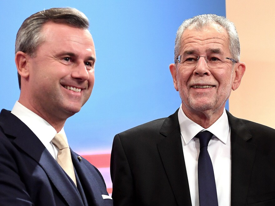 Austrian far-right candidate Norbert Hofer (L) and his rival Alexander Van der Bellen attend a post-selection TV talk with in Vienna on Dec. 4, 2016. Austrian far-right candidate Norbert Hofer on Sunday congratulated his opponent in presidential elections after projections indicated that he had lost.