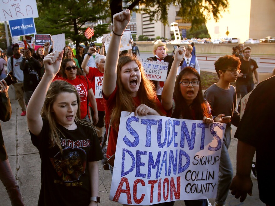 Young protesters chanted on Friday as they marched from City Hall to the Kay Bailey Hutchison Convention Center where the National Rifle Association is hosting an annual, four-day convention.