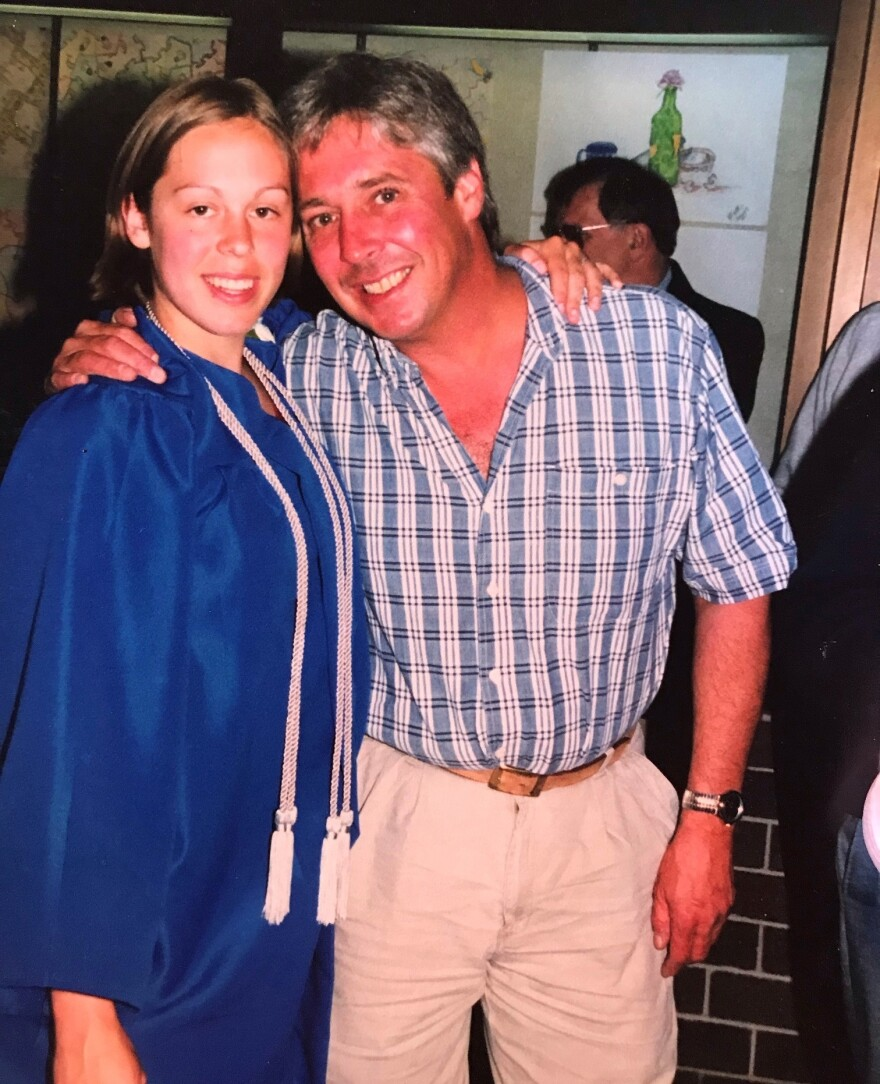 Erica Kufus with her father, Bradley Bundgaard, at her high school graduation in 2000.