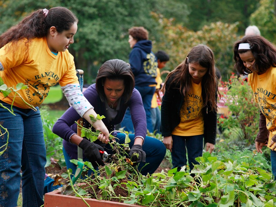 First Lady Michelle Obama, here with students from Bancroft Elementary School and Kimball Elementary School,  has done a lot to promote healthy family dinners and garden-fresh food.
