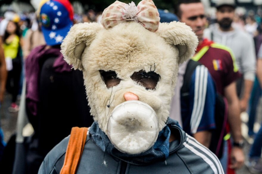 One opposition activist got creative (and fairly creepy) with a mask to protect against police officers' crowd-control devices. Dozens of people have been injured and more than 100 arrested since April 6, according to authorities.