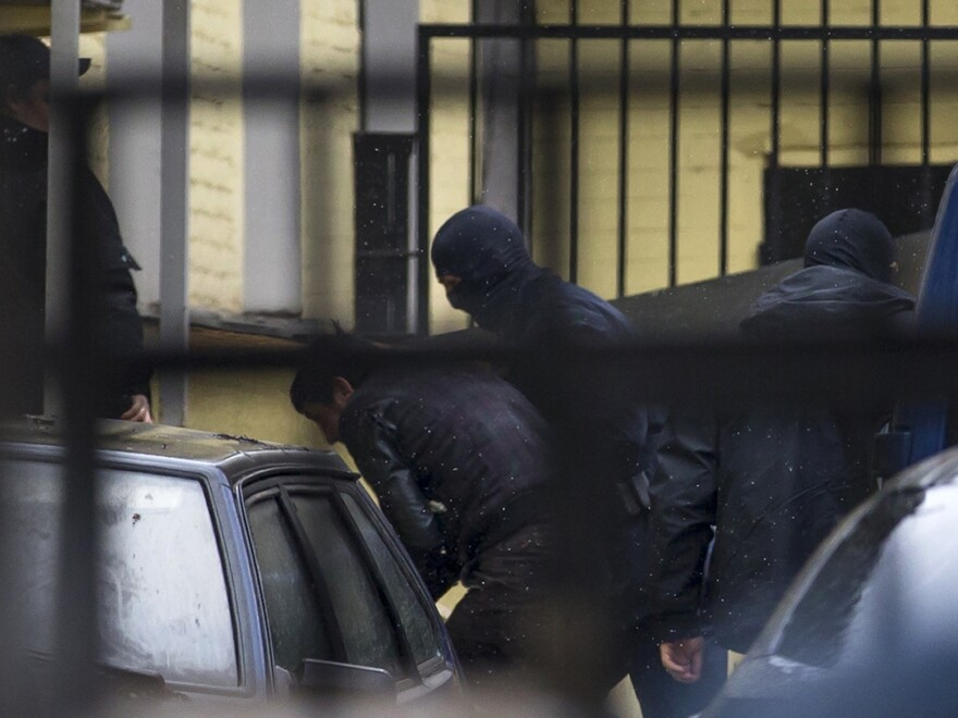 Police escort the suspects in the killing of Boris Nemtsov into a court house in Moscow, Russia, on Sunday. A total of five people have been arrested over the weekend in connection with the killing of the fierce opponent of President Vladimir Putin.