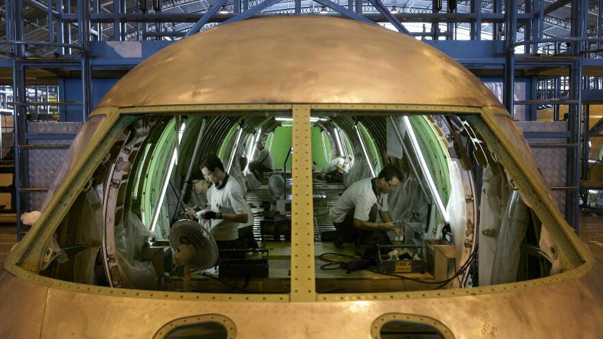 Brazilian technicians assemble an aircraft at an Embraer plant, in Sao Jose dos Campos, north of Sao Paulo, in 2007. Embraer is a relatively rare example of a high-tech industry in Latin America that has built an international reputation.