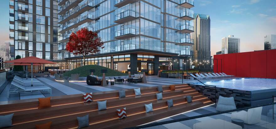 An architectural rendering shows the planned apartment building at One Cardinal Way (corner of Clark Avenue and Broadway). (Dec. 14, 2017)
