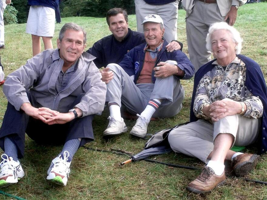 George W. Bush, Jeb Bush, former President George H.W. Bush and his wife, Barbara Bush, in September 1999 at the Ryder Cup in Brookline, Mass.