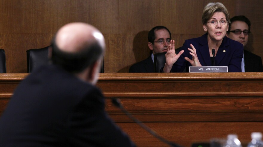 Sen. Elizabeth Warren, D-Mass., questions Federal Reserve Board Chairman Ben Bernanke during a Senate hearing last month. Senators from both ends of the political spectrum argue that financial reforms are insufficient to protect taxpayers from potential risks posed by large banks.