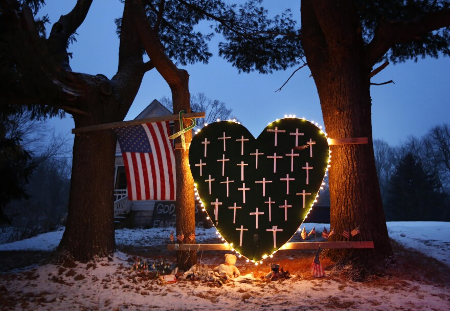 A makeshift memorial with crosses for the victims of the Sandy Hook Elementary School massacre stands outside a home in Newtown, Conn., in December 2013, a year after the shootings.
