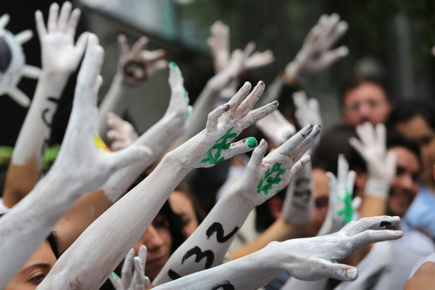 Student protesters stage a demonstration front of Mexico's Federal Election Commission on Tuesday in Mexico City.