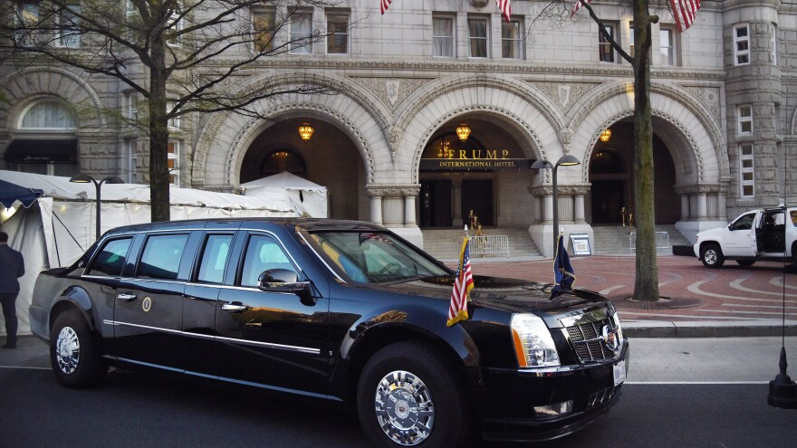 """The presidential limousine, aka """"The Beast,"""" is parked in front of the Trump International Hotel as President Trump attends dinner with supporters on April 30 in Washington, D.C."""