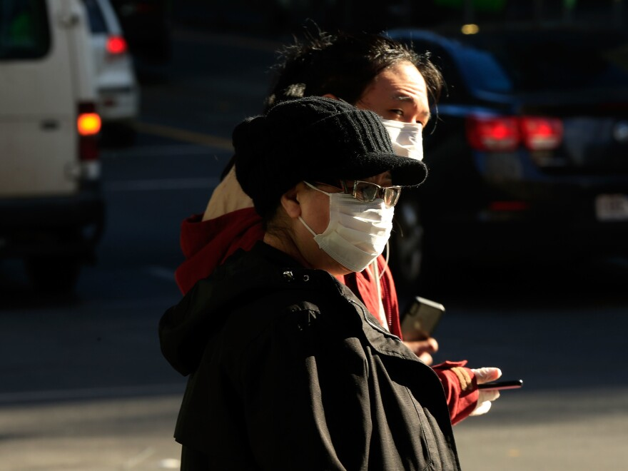 People in Melbourne, Australia, wear face masks on Thursday. Victoria has recorded 317 new cases of coronavirus in 24 hours, the highest daily total recorded in the state since the pandemic began.