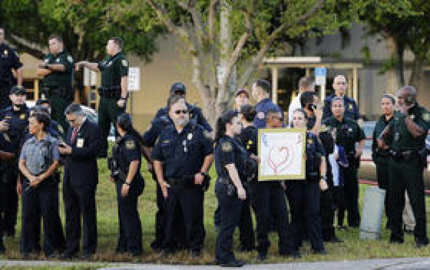 Police line the campus of Marjory Stoneman Douglas High School on the first day back after the shooting, Feb. 28, 2018. Sophomore Annabel Claprood didn't feel safe at school, even with police and security guards there.