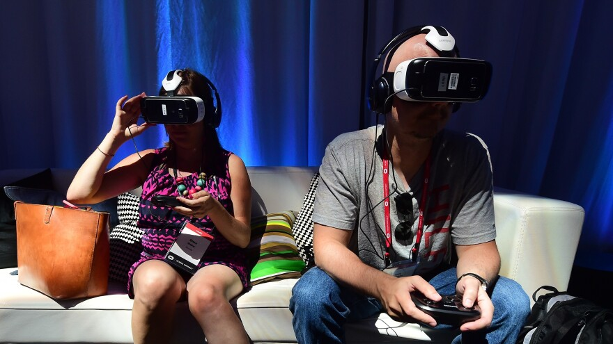 People sample the Oculus-made Samsung Gear VR Virtually Reality headset Sept. 24 in Hollywood, Calif., at the Oculus Connect 2 event.