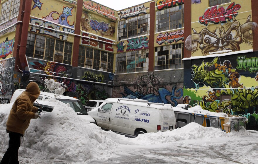 A man clears snow from a driveway near 5Pointz, a graffiti art gallery in New York, in January 2011.