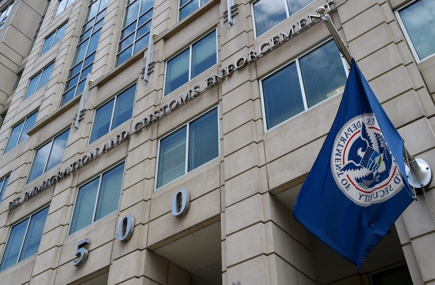 The Department of Homeland Security flag flies outside the Immigration and Customs Enforcement (ICE) headquarters in Washington, DC.