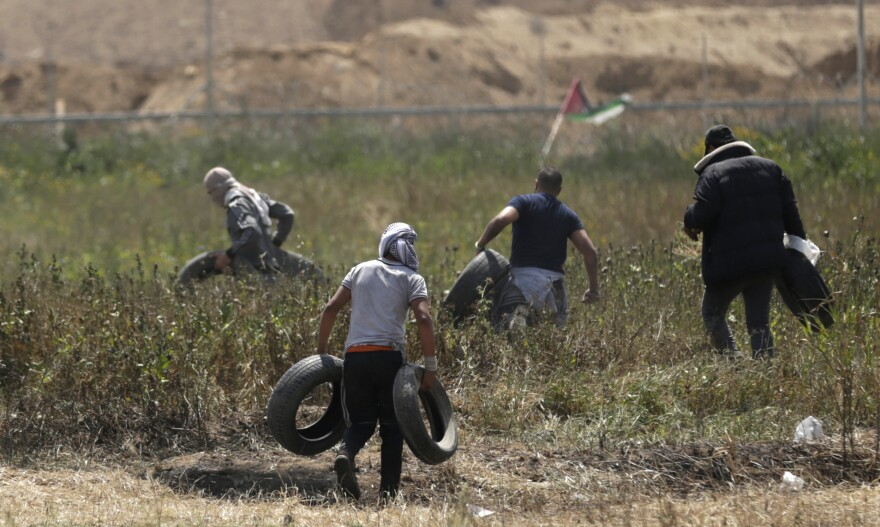 Palestinian youth brought tires close to the border to burn during Friday's protests.