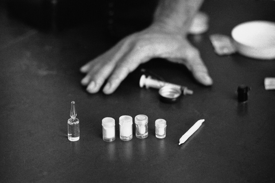 Vials of heroin and a marijuana joint shown in Saigon in 1971.