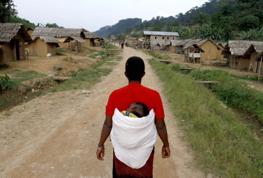 A woman walks down the main road in the village of Luvungi in the Democratic Republic of the Congo. In 2010, Hutu rebels and local militias raped more than 280 women and children as punishment for the villagers' alleged support of the Congolese Defense Forces.
