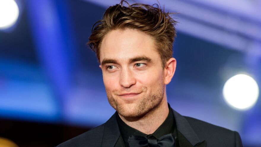 """In the late 2000s, Robert Pattinson began playing vampire Edward Cullen in the film adaptations of the <em>Twilight</em> novels. """"It was so sudden, it didn't feel real to me at all,"""" he says of the fame."""