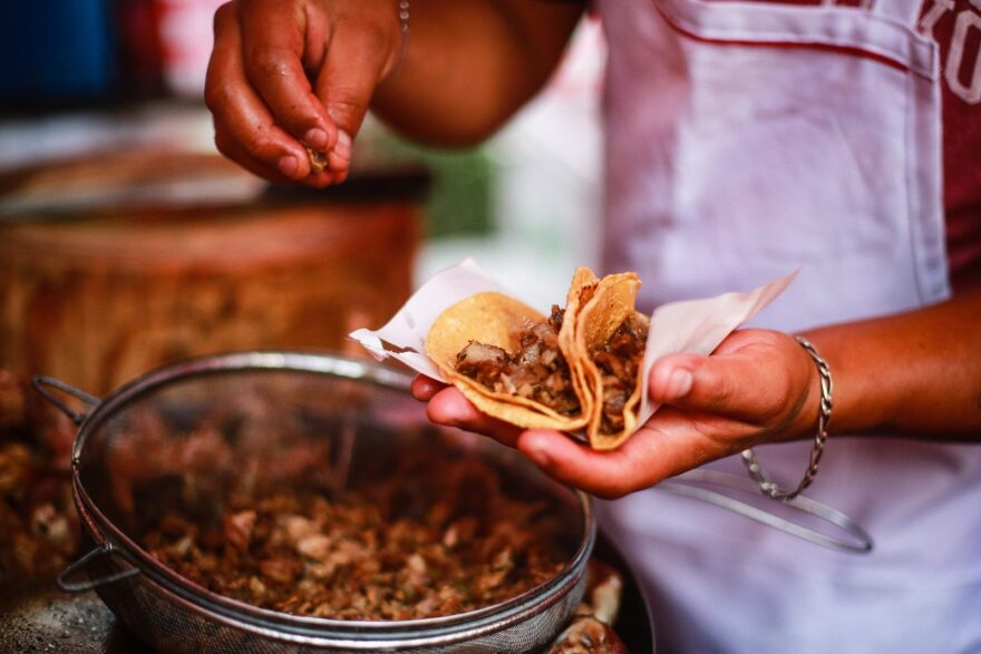 """Heriberto prepares tacos in """"El Jarocho"""" stand at Insurgentes Avenue on in Mexico City, Mexico."""