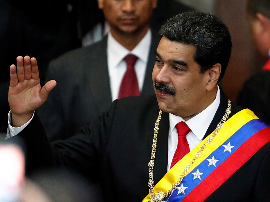 Venezuela's sitting president, Nicolás Maduro, attends a ceremony Thursday in Caracas to mark the opening of the judicial year at the Supreme Court of Justice. Opposition leader Juan Guaidó has declared himself the interim president, but Maduro has not ceded power.