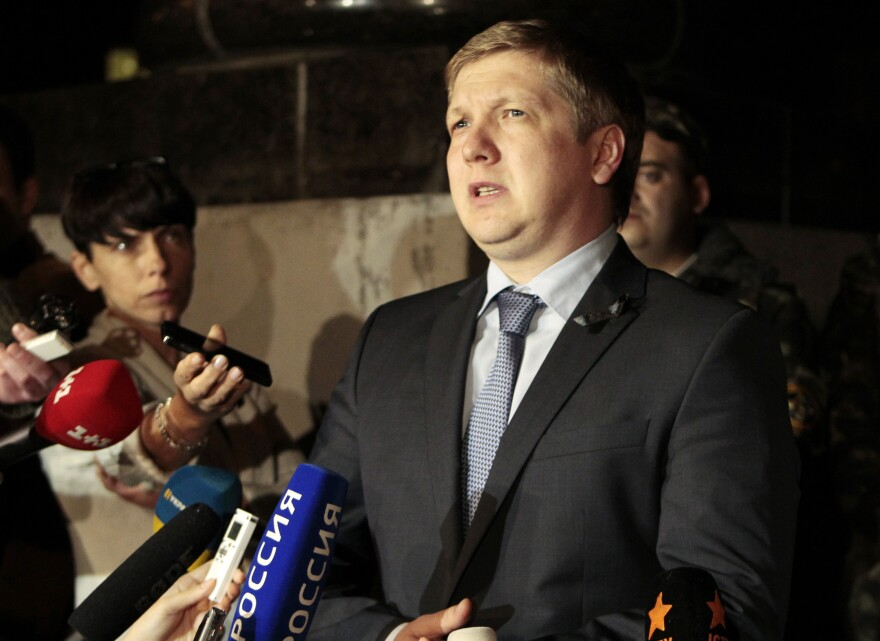 Naftogaz Chairman Andrew Kobolev speaks to reporters Monday outside the government building in Kiev, Ukraine.